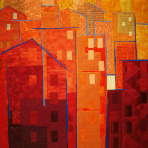 Sun Sets on Building in Red by Lisa & Lori Lubbesmeyer