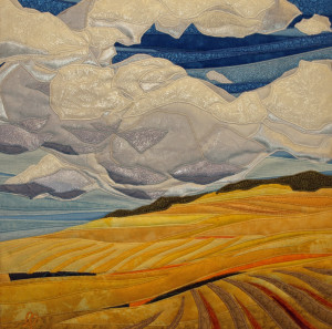 Billowing Clouds is a fiber wall hanging created by twin artists, Lisa and Lori Lubbesmeyer. The Lubbesmeyer twins are a trained printmaker and oil painter who also work collaboratively in fiber.