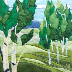 Spring Leaves is a fiber painting created by twin artists, Lisa and Lori Lubbesmeyer.