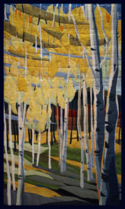 Quaking Aspen is a 'fiber painting' created by twin artists, Lisa and Lori Lubbesmeyer.